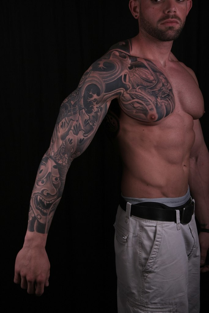 Oriental-tattoo-sleeve-on-chest-six-pack-abs