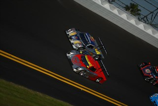 The #10 SunTrust Racing Dallara racing hard with the pole sitter | by IndyCar Series
