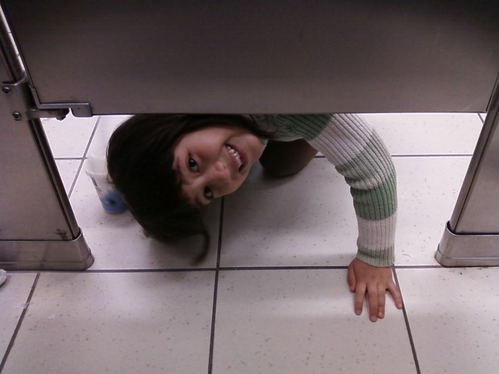 scarlet peeking under my bathroom stall marie sky flickr