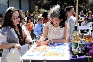signing the ketubah | by JuNoah