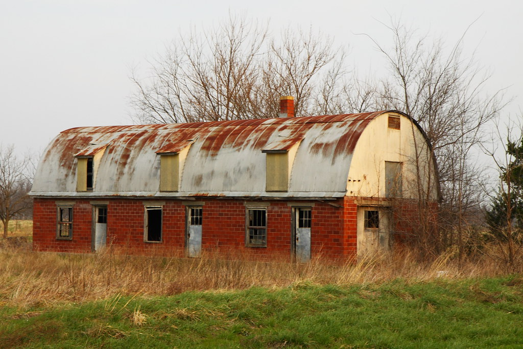 Red brick barn with round metal roof gordon huggins flickr for Red metal barn