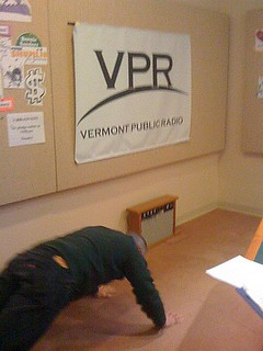 David does a few push-ups in the Talk Studio | by Vermont Public Radio