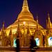 People walking past Shwedagon Pagoda