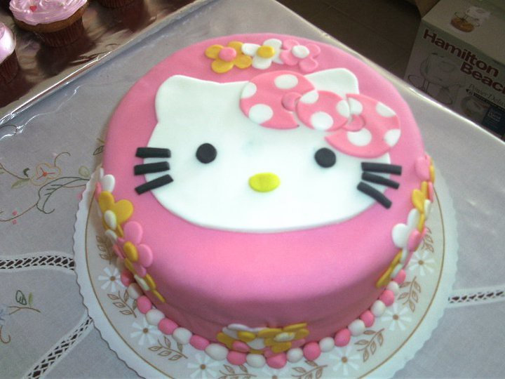 Hello Kitty Cake Design In Red Ribbon