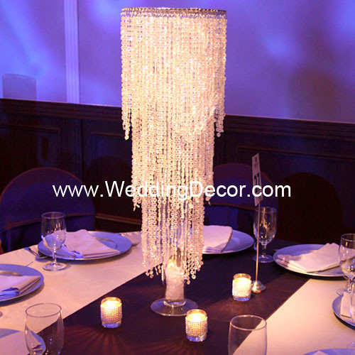 Wedding centerpieces crystal chandelier an acrylic for Chandelier table decorations