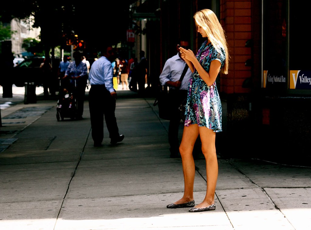 new york city seventh avenue blond girl on cell phone | Flickr