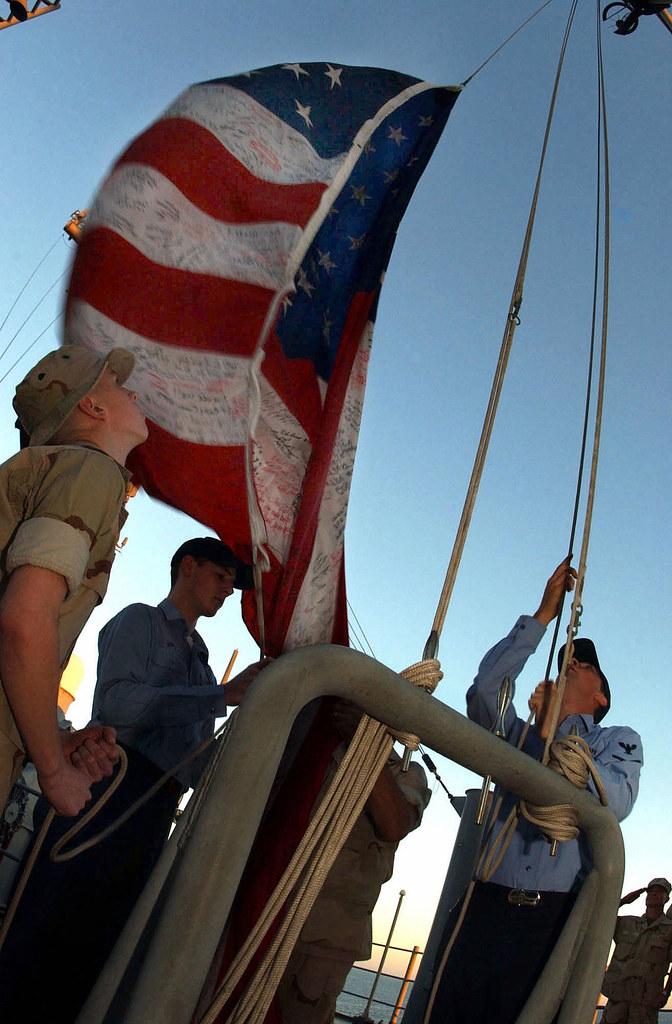 ground zero flag raised on uss bataan  2001