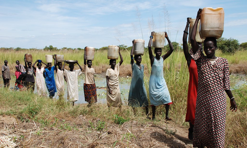 Women collecting water in aweil women in aweil northern for African crops and slave cuisine