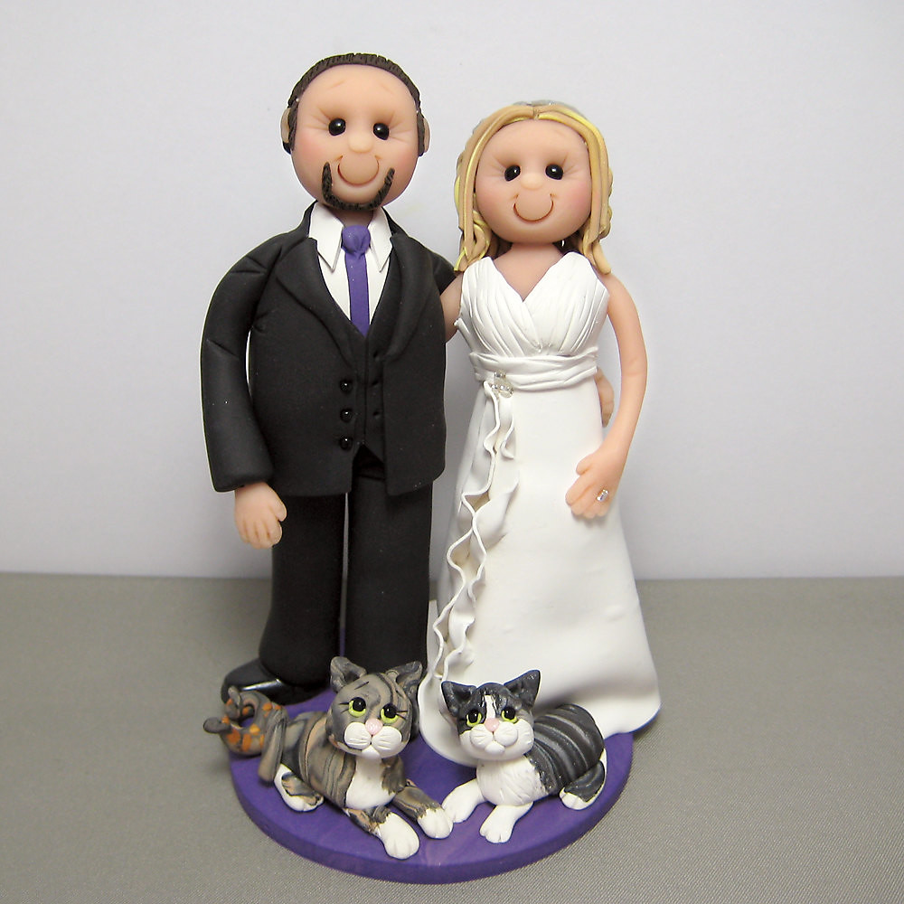 wedding cake toppers with dogs and cats wedding cake topper with their cats and a snake all of 26631