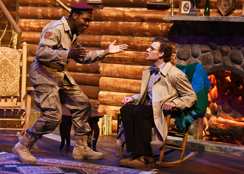 """Two actors interact on stage during the play """"The Foreigner."""""""