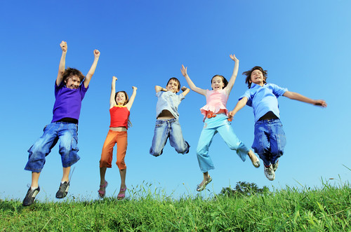 Group of five happy children jumping outdoors. | by Lighttruth