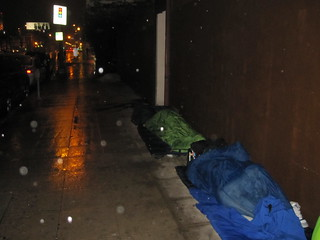 homeless sleeping in rain | by invisiblepeople.tv