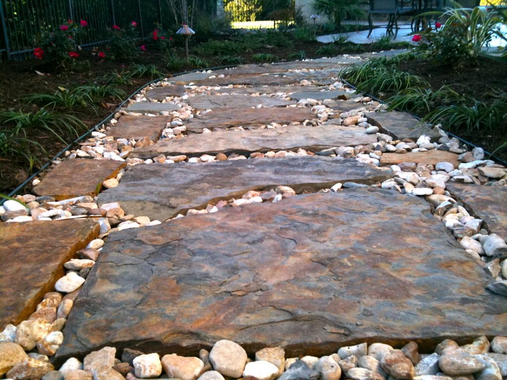 Landscaping design ideas around a pool jack williams for Garden designs around pools
