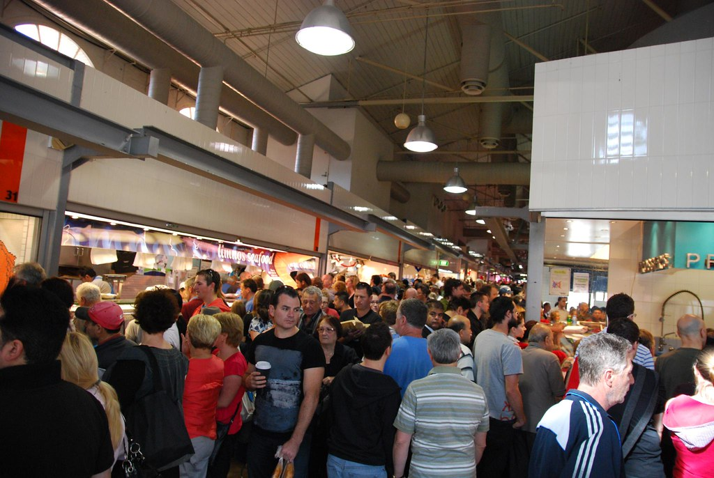 Crowds at limnos seafood queen victoria market for Fish market queens
