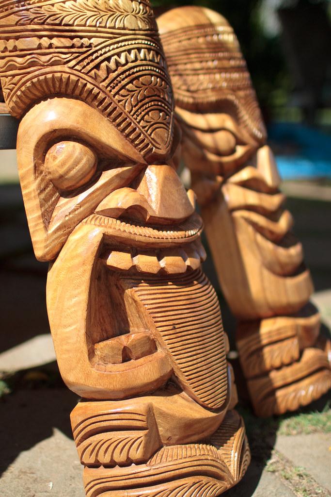 Hand carved hawaiian tikis a local man was