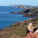 Vivid red-orange rocky coastline of Menorca