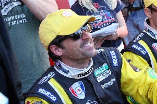 Patrick Dempsey, former INDYCAR team owner, smiles for a fan picture | by IndyCar Series
