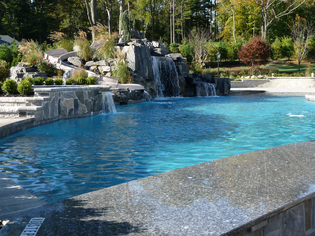 Luxury pool garden landscaping and pavers custom for Luxury pools with waterfalls