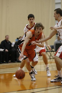 Chas Kok being watched by two Calgary players (vertical Jan 28, 2011) | by TRU WolfPack