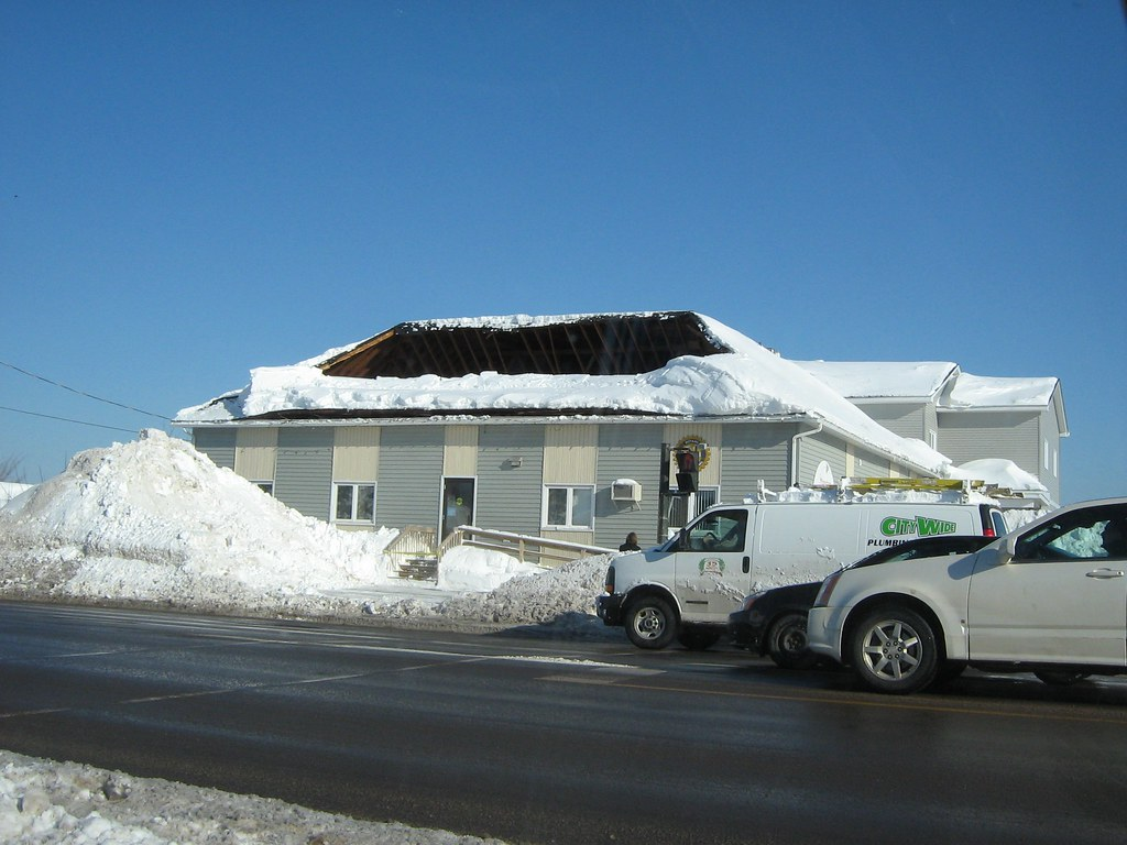 Roof collapse due to snow load a large portion of the for Snow loads on roofs
