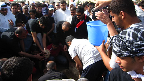 Splashing water onto tomb | by Al Jazeera English