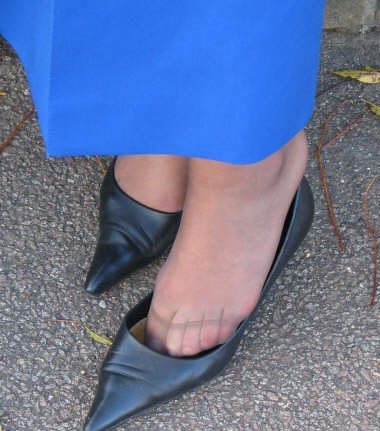 Candid feet shoeplay in nylons at conference
