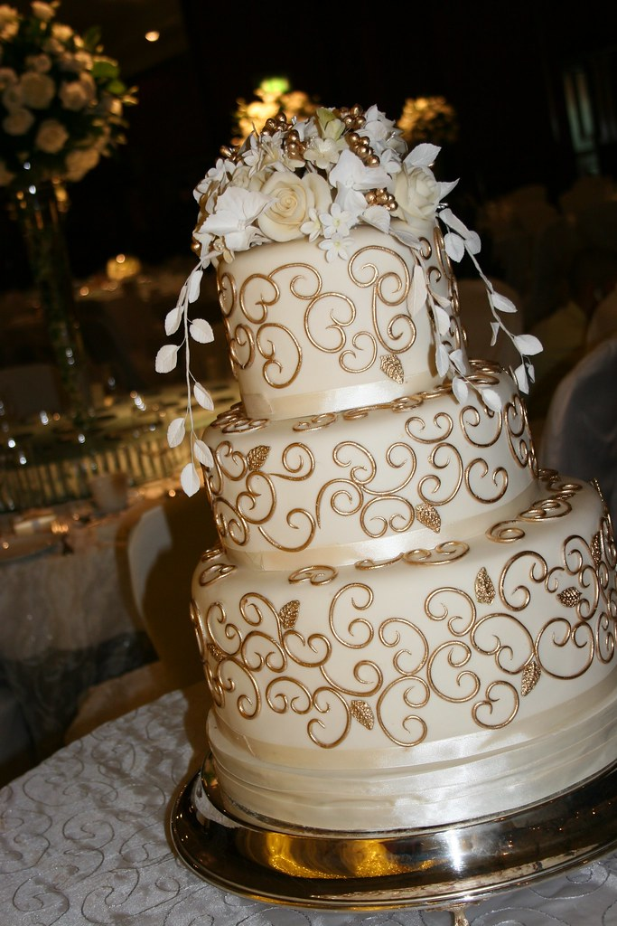 gold scroll cake 2 cream and gold three tier wedding