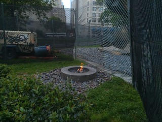 The fence moves around the eternal flame in front of the World Trade Center Sphere | by agreatbigcity