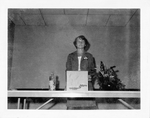 A young Peggy Whitson delivering a 4-H presentation