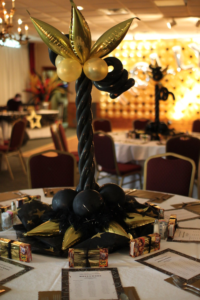 Hollywood themed balloon decor black and gold