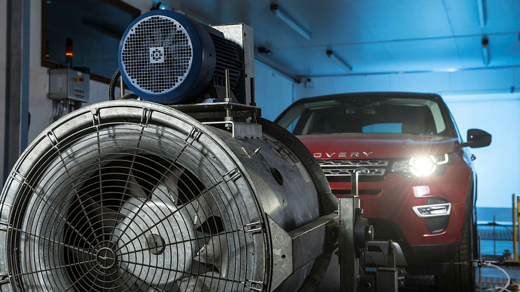 SUV and a big fan in a research facility