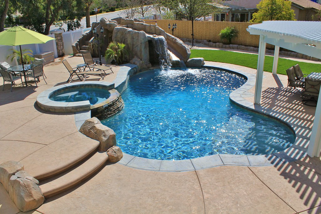 Freeform pool spa combo with custom built slide and outd for Pool design jobs