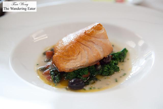 Seared Scottish salmon, sautéed broccoli rabe, tomato concasse, cauliflower crema