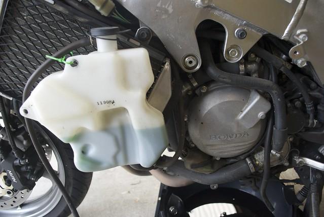 Moving overflow bottle away from alternator cover