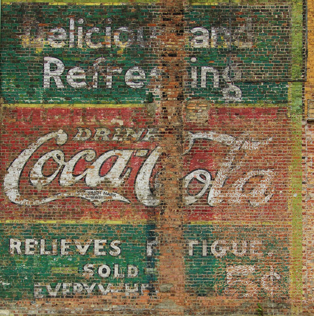 Coca Cola Advertisement On Brick Wall Vintage Ad For