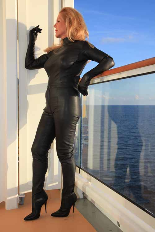 A latex girl black latexthigh high pac boots - 2 4