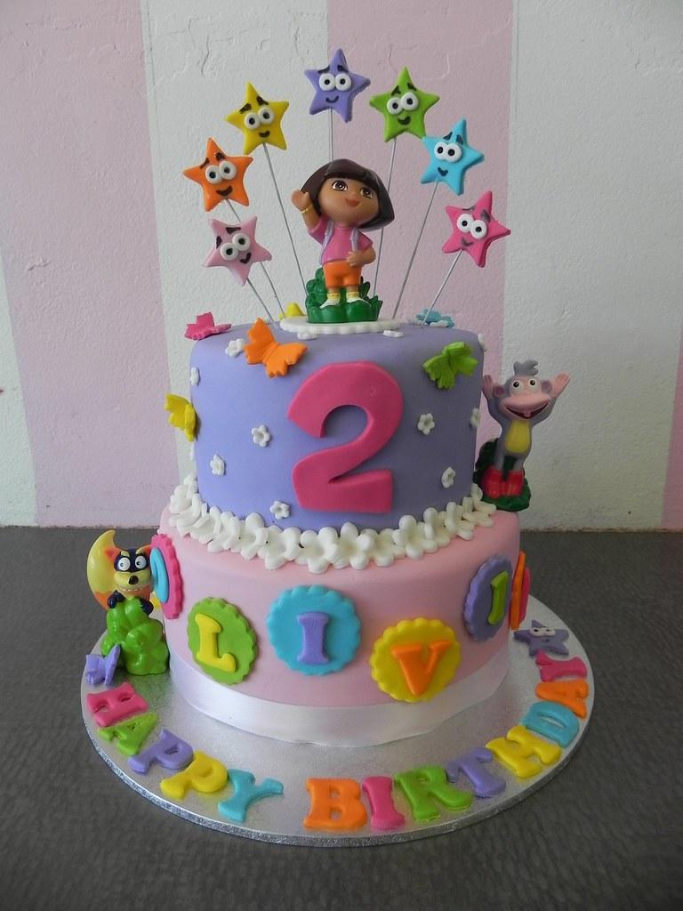 Cake Design Dora L Exploratrice : 2 tier Dora cake Cupcake Spot Flickr