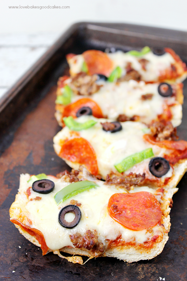 French Bread Pizza on a cookie sheet.