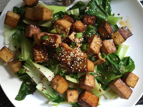 Photo of vegan tofu, ginger tofu stir fry on bok choy