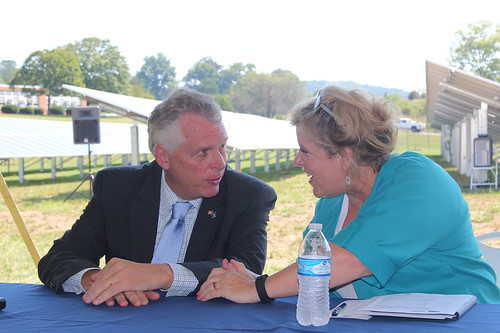 Deputy Secretary Lillian Salerno speaking with Virginia Governor Terry McAuliffe