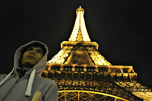 A moment here. Eiffel Tower in golden lighting.