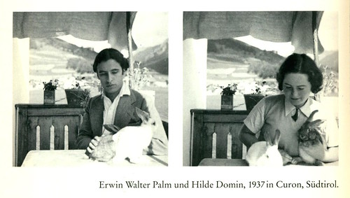 Two old, black-and-white photos, each of a person holding rabbits. The label says, 'Erwin Walker Palm and Hilde Domin, 1937 in Curon, Südtirol.'