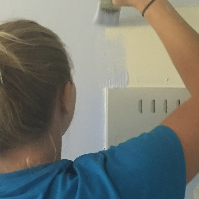"A first-year medical student from SUNY Upstate Medical University paints a family bedroom baby blue at the Salvation Army during the university's annual ""Day of Service"" held Sept. 11. 