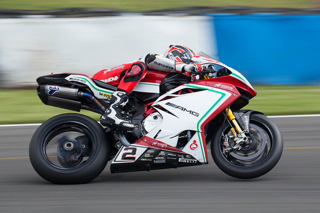 Leon Camier lifts the front wheel