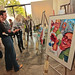 Guests view artwork at Jordan Winery's 4 on 4 Art Competition at Hadid Gallery on April 11