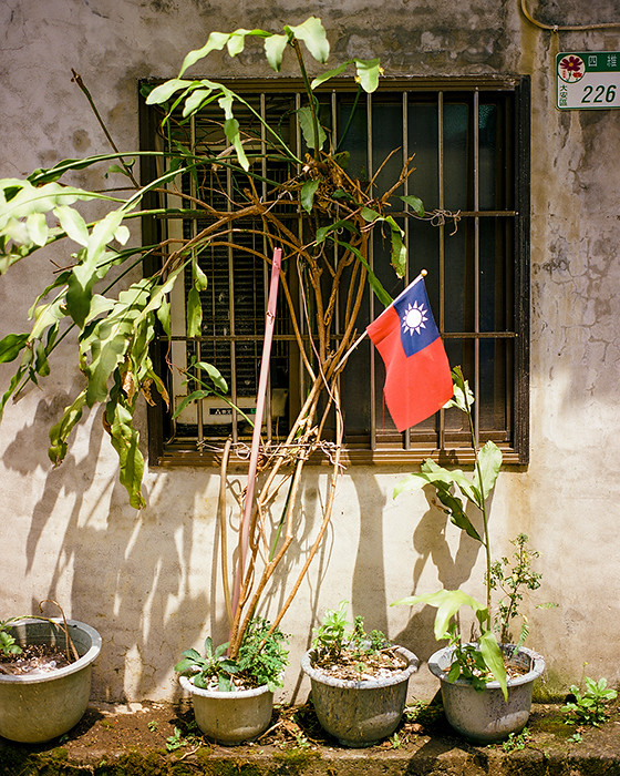 © 2016. The Taipei flag is displayed outside an apartment in the Da'an District. Saturday, Sept. 10, 2016. Portra 160+1, Pentax 6x7.
