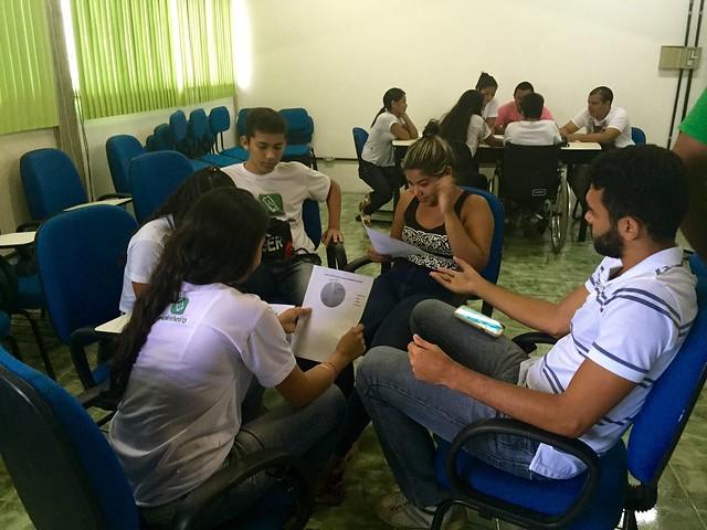 Luiz, PalmasLab team member speaks to group