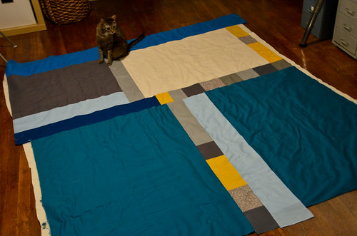 Z inspects the quilt sandwich for puckers