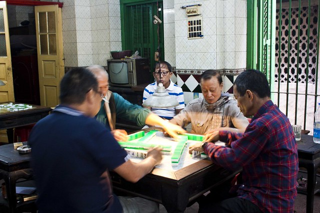 Playing Mahjong in Chinese Club in Tiretta Bazar, Kolkata, India