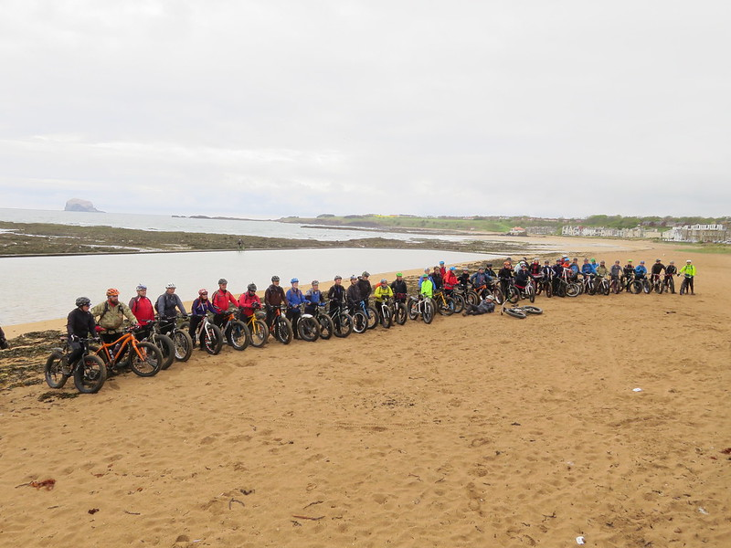 Many fatbikes on a scenic beach